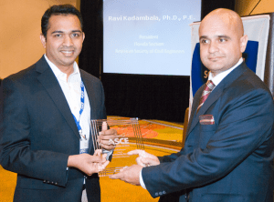Dr. Ravi Kadambala, Senior Project Professional with the SCS office in Boca Raton, Florida receives the editor-in-chief award from Adnan Javed, President of the ASCE Florida Section.