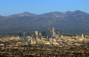 Downtown Los Angeles with San Gabriel Mountains in the background.